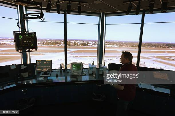 Air Traffic Controller David Spitnale works in the control tower at Opalocka airport on March 4 2013 in Opalocka Florida Due to sequestration cuts...