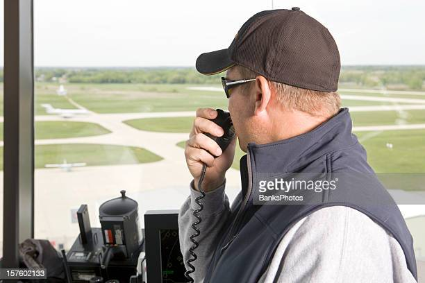 Air Traffic Controller Directing Landed Plane from Control Tower