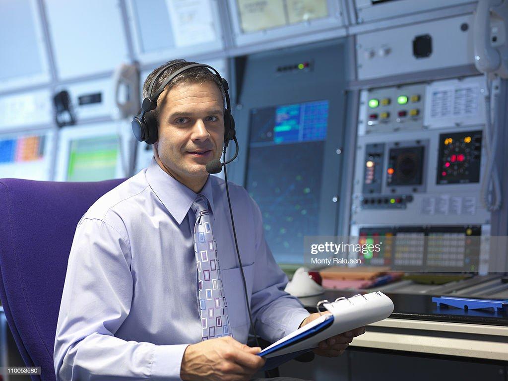 Air traffic controller in radar room