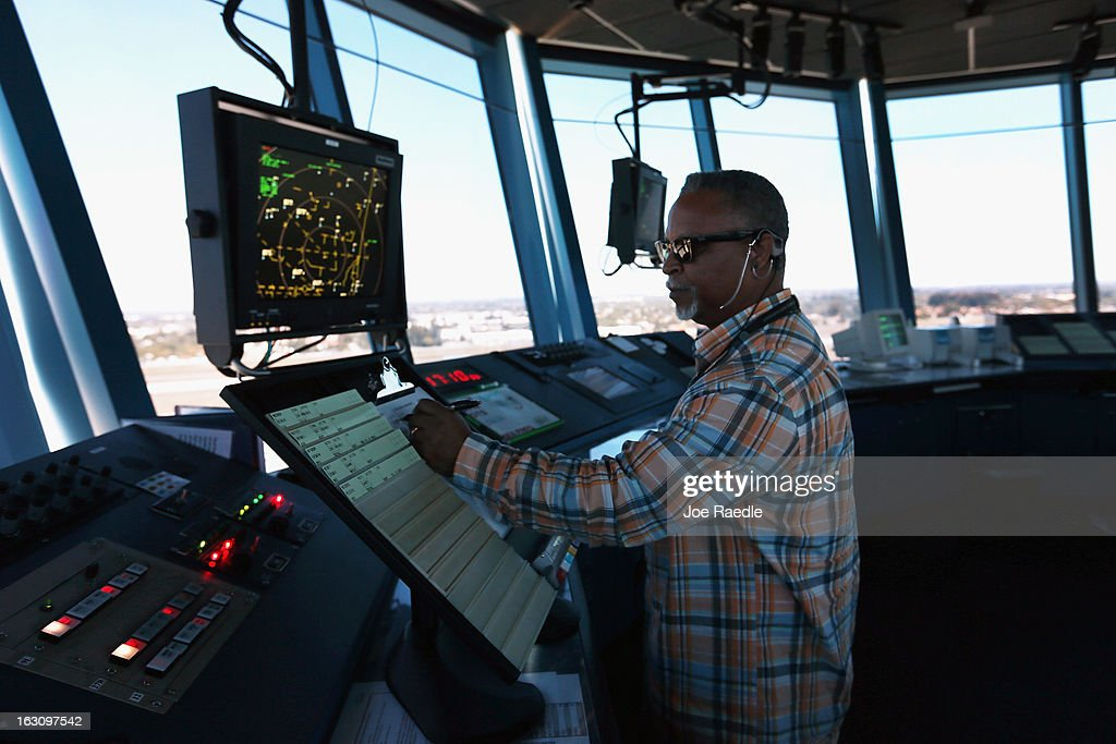 Air Traffic Controller Robert Moreland works in the control tower at Opalocka airport on March 4 2013 in Opalocka Florida Due to sequestration cuts...