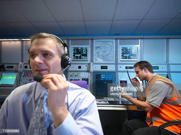Air traffic controllers in radar room