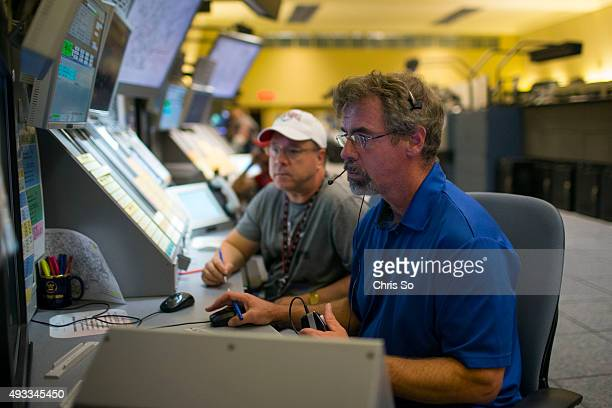 Air traffic controllers Marvin Dykun rear and Glen Chisholm manage high altitude flights over Ontario at Nav Canada's Toronto Air Control Centre A...