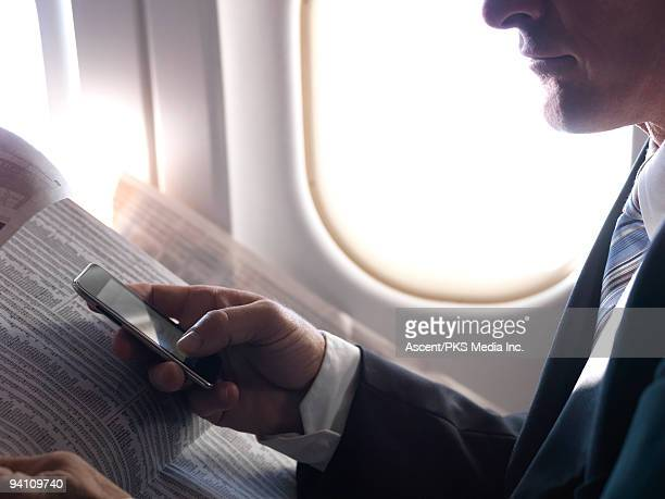 Air traveler sends text, with financial columns,