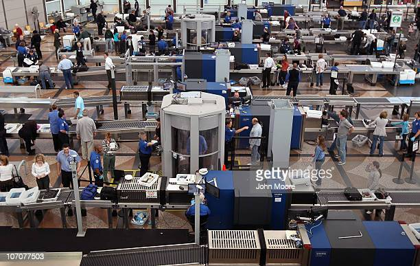 Air travelers move through a main security checkpoint at the Denver International Airport on November 22 2010 in Denver Colorado The TSA is bracing...