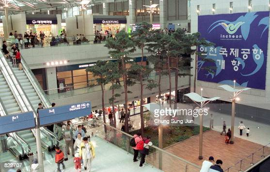 Air travelers wait for their flights April 5 2001 inside the newly opened Incheon International Airport that lays 32 miles west of Seoul South Korea...