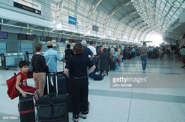 Air travelers wait in long lines in the terminal at Pearson International Airport a day after the crash of Air France flight 358 August 3 2005 in...