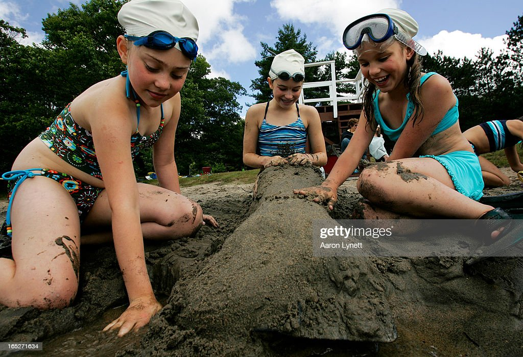 Campers Brie Craig and Maria Smirnova turn their friend Adie Mathison into a mermaid by covering her in sand and placing a diving flipper over her...