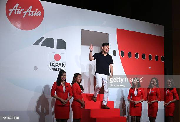AirAsia Bhd flight attendants line up as billionaire Hiroshi Mikitani chairman and chief executive officer of Rakuten Inc arrives for a news...