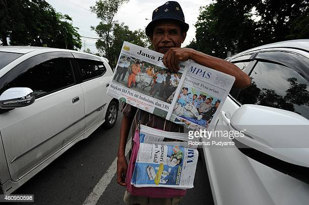 AirAsia flight QZ8501 is the front page story in many local newspapers on January 1 2015 in Surabaya Indonesia A massive recovery operation is...