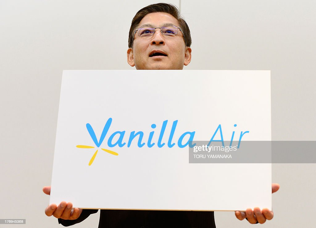 AirAsia Japan President Tomonori Ishii unveils its new brand name 'Vanilla Air' during a press conference in Tokyo on August 20, 2013. Following a break-up with AirAsia, the surviving budget carrier AirAsia Japan, now wholly-owned All Nippon Airways (ANA), will begin its service under the new name from December. AFP PHOTO/Toru YAMANAKA