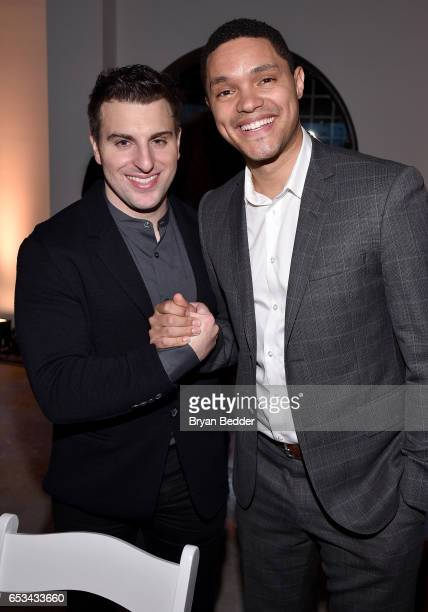 Airbnb CEO Brian Chesky and Trevor Noah attend Experience Harlem hosted by Airbnb and Ghetto Gastro on March 14 2017 in New York City