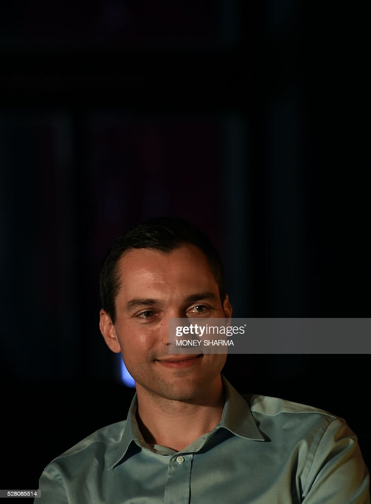 Airbnb co-founder Nathan Blecharczyk gestures during a press conference in New Delhi on May 4, 2016. Airbnb, a community-driven hospitality company, announced travel on the platform in India had nearly tripled in the last year, positioning it as one of the fastest growing markets in the world. / AFP / MONEY