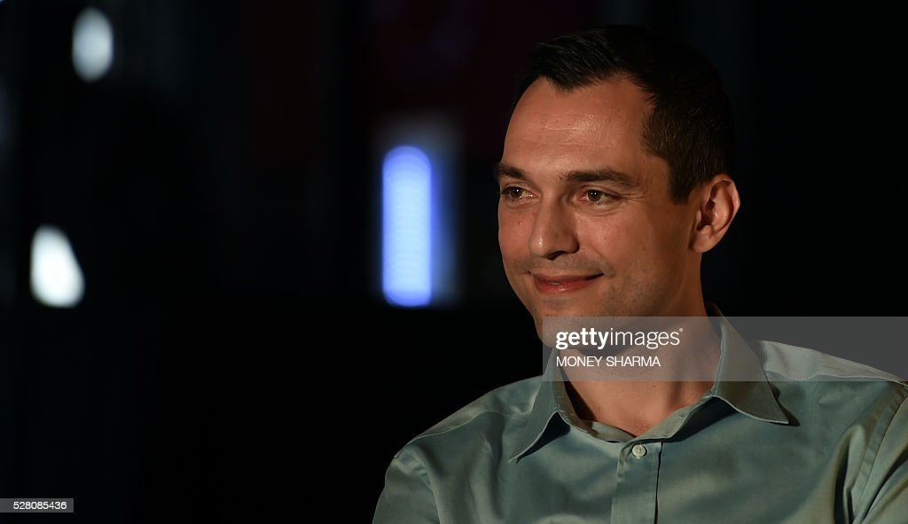 Airbnb co-founder Nathan Blecharczyk looks on during a press conference in New Delhi on May 4, 2016. Airbnb, a community-driven hospitality company, announced travel on the platform in India had nearly tripled in the last year, positioning it as one of the fastest growing markets in the world. / AFP / MONEY