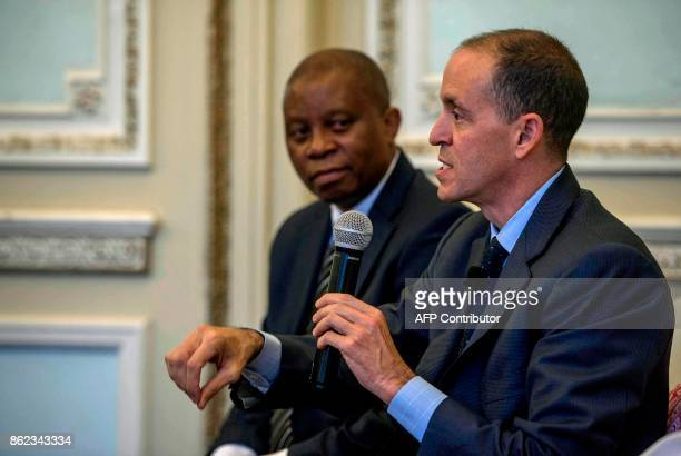 Airbnb Head of Global Policy and Public Affairs Chris Lehane gestures during a press conference with Johannesburg Mayor Herman Mashaba at...