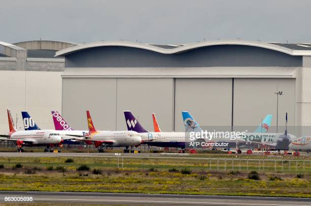 Airbus A320 of various airline companies are parked on the tarmac of the ToulouseBlagnac airport near Toulouse on October 19 2017 / AFP PHOTO /...