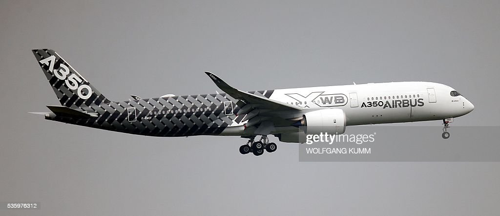 Airbus A350 lands at the International Aerospace Exhibition (ILA) in Schoenefeld on May 31, 2016. The Aerospace Exhibition at Schoenefeld Airport near Berlin takes place from June 1 till 4. / AFP / dpa / Wolfgang Kumm / Germany OUT