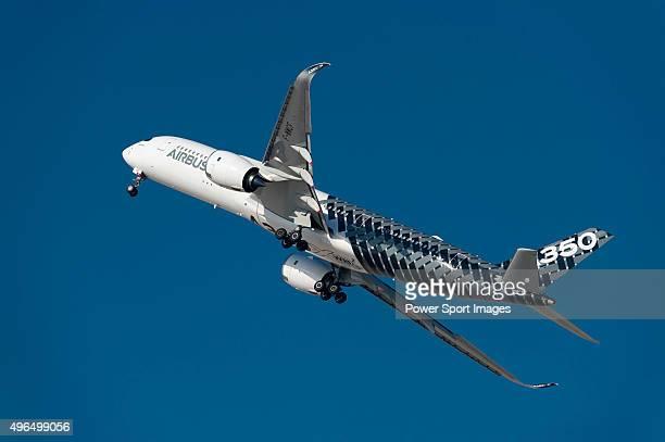 Airbus A350 XWB aircraft manufactured by Airbus SAS performs an aerial display during the Dubai Airshow 2015 on November 9 2015 in Dubai United Arab...
