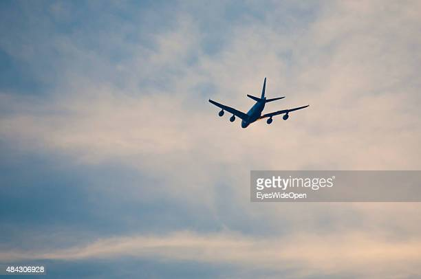 Airbus A380 passenger jet in sunset at approach to Franz Josef Strauss International Airport Munich on August 12 2015 in Munich Bavaria Germany