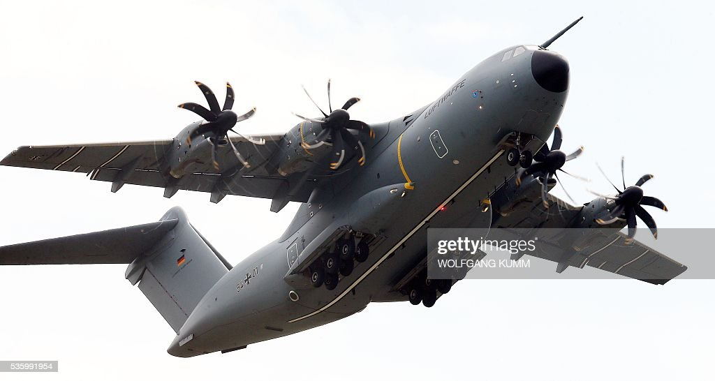 Airbus A400M of German Air Forces flies over the International Aerospace Exhibition (ILA) in Schoenefeld on May 31, 2016. The Aerospace Exhibition at Schoenefeld Airport near Berlin takes place from June 1 till 4. / AFP / dpa / Wolfgang Kumm / Germany OUT