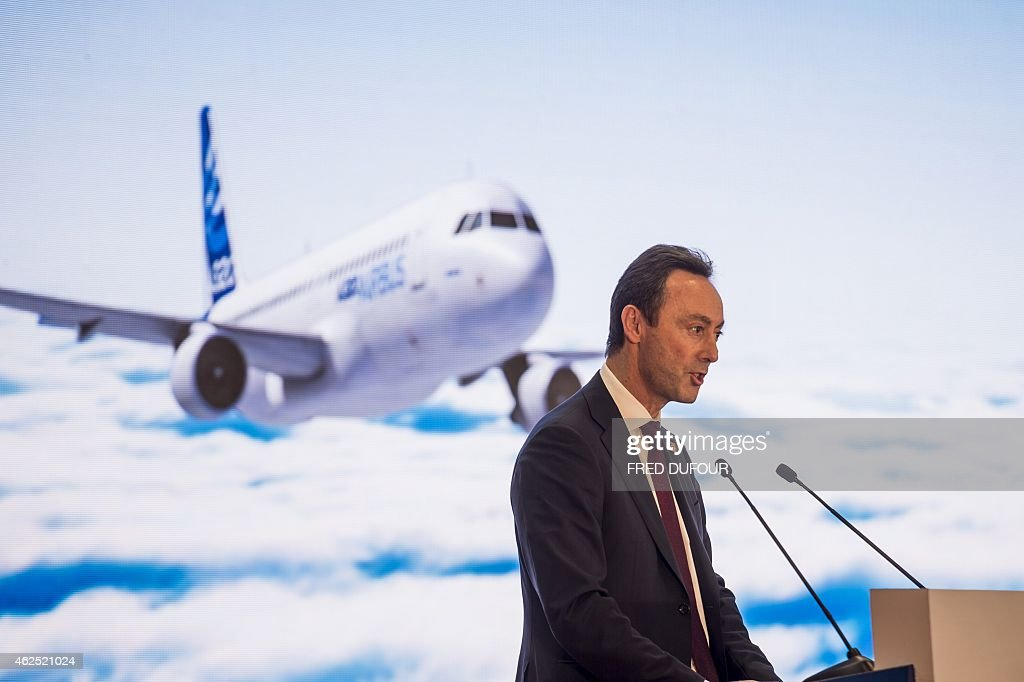 Airbus Chief Executive Officer Fabrice Bregier addresses French Prime Minister Manuel Valls and journalists during a visit to an Airbus factory in Tianjin on January 29, 2015. Valls will meet his counterpart Li Keqiang and President Xi Jinping in Beijing during the three-day trip.
