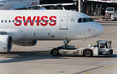Airbus of Swiss International Air Lines pushed by aircraft tug