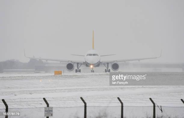 Aircaft prepare to leave Leeds Bradford airport during a heavy snow storm on March 22 2013 in Yorkshire United Kingdom Heavy snow is causing...