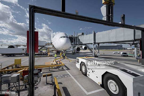 A380 aircraft and tug at stand at airport