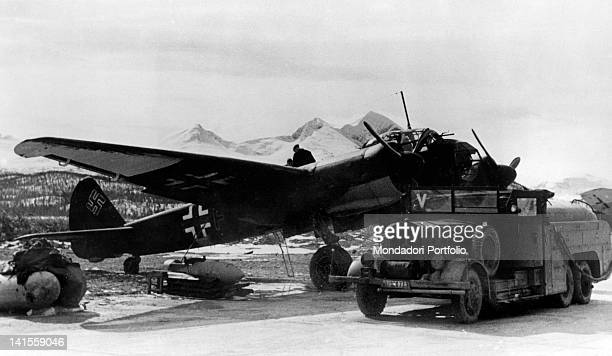 Aircraft bound for Arkhangelsk to attack the Allied are refuelled in an Axis airbase Finland July 1942
