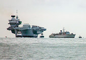 Navy aircraft carrier entering Portsmouth naval port