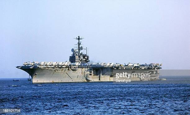 Aircraft carrier sailing in the open ocean