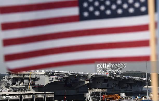 Aircraft carrier USS Ronald Reagan arrives at the US Navy base in Yokosuka a suburb of Tokyo on October 1 2015 The US Navys Nimitzclass aircraft...