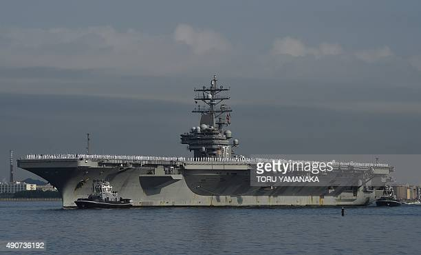 Aircraft carrier USS Ronald Reagan arrives at the US Navy base in Yokosuka a suburb of Tokyo on October 1 2015 The US Navys Nimitzclass aircraft...