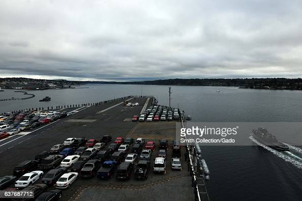 Aircraft carrier USS Ronald Reagan departs from Bremerton Washington for San Diego following over a year of maintenance Puget Sound 2013 Image...