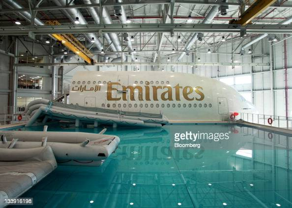 Aircraft emergency escape shoots extend into the training pool next to an Emirates Airline simulator the Airbus A380 at the Emirates Aviation College...