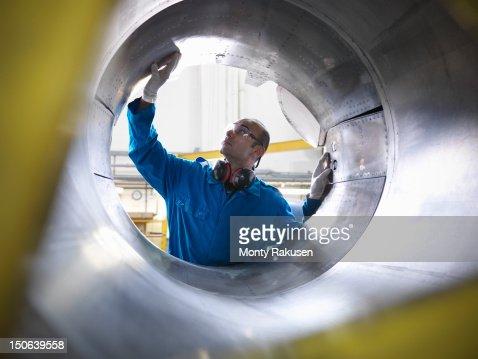 Aircraft engineer inspecting reverse thruster of 737 jet engine