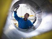Aircraft engineer inspecting reverse thruster of 737 jet engine