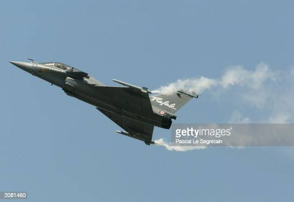 Aircraft Fighter Rafale of Dassault Aviation company is seen during an exhibition flight at the opening day of the Paris Air Show on June 14 2003 in...