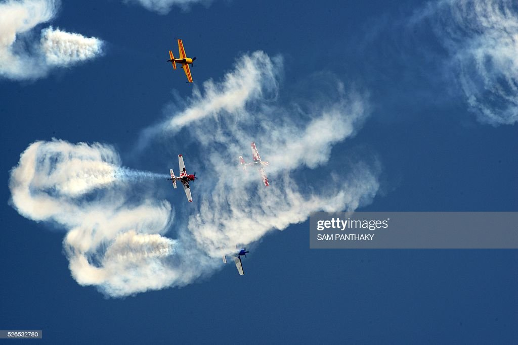 Aircraft from Britain's Global Stars Aerobatic team perform a display routine as they take part in the second day of a three day airshow in Ahmedabad on April 30, 2016. / AFP / SAM