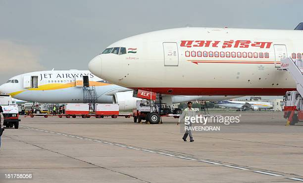 Aircraft from Indian carriers Jet Airways and Air India sit on the tarmac at Indira Gandhi International Airport in New Delhi on September 8 2012 AFP...