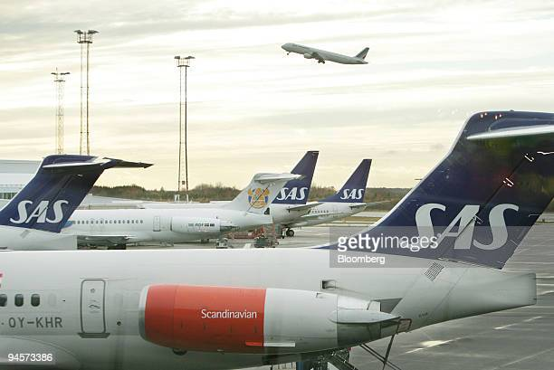 Aircraft from SAS Scandinavian Airlines sit on the tarmac at Arlanda Airport near Stockholm Sweden on Tuesday Oct 30 2007 SAS has announced recently...