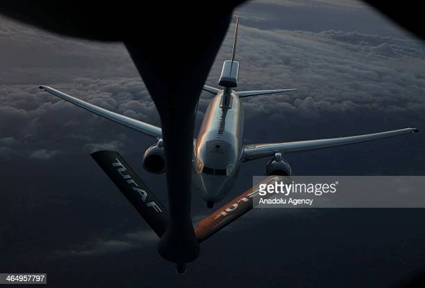 AWACS aircraft hooks up a boom to receive midair refueling from a refueler tanker over Adana Turkey on January 14 2014 Turkish Air Force's F16s and...