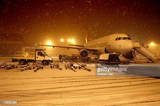 Aircraft in snow blizzard at airport