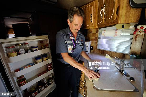 Aircraft mechanic Jere Herr from Indianapolis Indiana prepares his lunch in his recreational vehicle at the motor home colony of Parking Lot B of the...