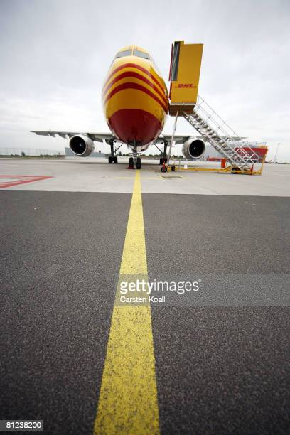 A aircraft of the transportation company DHL is seen at the airport LeipzigHalle on May 26 2008 in Leipzig Germany DHL Express opened a new european...