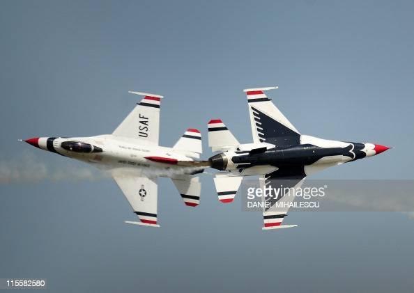 Aircraft of the US Air Force air demonstration squadron the Thunderbirds fly over Kogalniceanu airport near Constanta 230 kms east of Bucharest on...