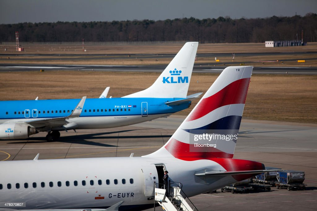 Aircraft operated by British Airways, a unit of International Consolidated Airlines Group SA (IAG), right, and Air France-KLM Group sit on the tarmac at Tegel airport, operated by Flughafen Berlin Brandenburg GmbH, in Berlin, Germany, on Wednesday, March 12, 2014. Berlin's Tegel airport has subsisted by chance alone, defying the odds as passenger growth outpaces every other major hub in Western Europe. Photographer: Krisztian Bocsi/Bloomberg via Getty Images