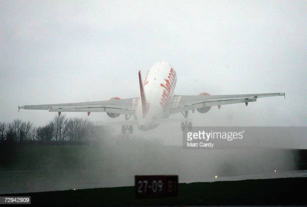 A aircraft operated by the budget airline EasyJet takes off in the rain from Bristol International Airport January 7 2006 in Bristol England...