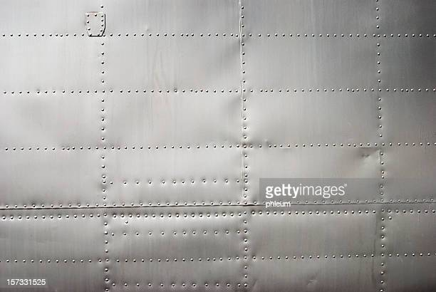 Aircraft siding background with rivets and soft shadows