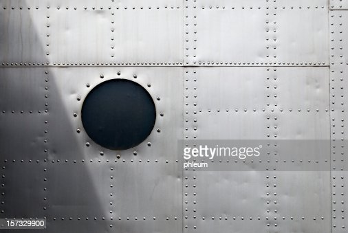 Aircraft Rivet Types : Aircraft siding with circular window and rows of rivets