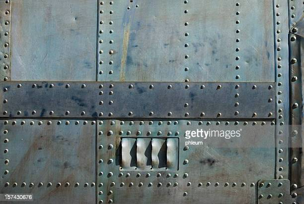 Aircraft siding with rivets
